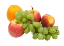 Green grapes. In an environment of tasty fruit on a white background Royalty Free Stock Image