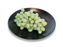 Green grapes on black dish  Royalty Free Stock Photo
