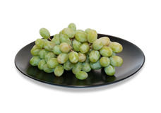 Green grapes on black dish  Stock Photos