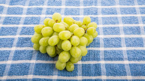 Green Grapes on Blue Towel Royalty Free Stock Photos