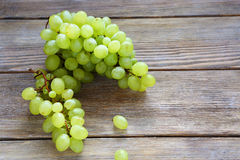 Green grapes on board Royalty Free Stock Photo