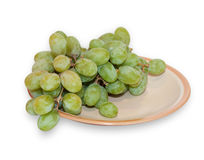 Green grapes on brown dish isolated Royalty Free Stock Images