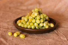 Green grapes on a clay brown dish Royalty Free Stock Photos
