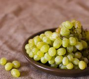 Green grapes on a clay brown dish Stock Photography