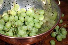 Green Grapes in Colander. This is an image of green grapes in a copper colander stock image