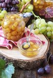 Green grapes confiture in jar Stock Photography