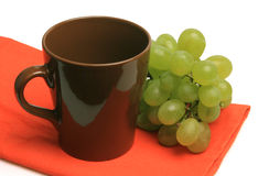 Green grapes and cup Stock Photography