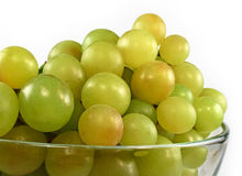Green grapes in glass bowl isolated Stock Photography