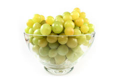 Green grapes in glass bowl isolated Royalty Free Stock Photo