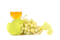 Green grapes with leaf and wine in the glass Royalty Free Stock Photo