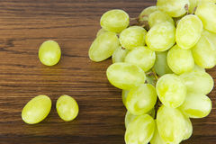 Green grapes on oak shelf Royalty Free Stock Image