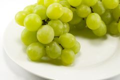 Green grapes on a plate Stock Images