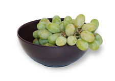 Green grapes in purple cup  Royalty Free Stock Image