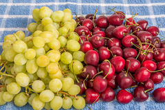 Green Grapes and Red Cherries Royalty Free Stock Image
