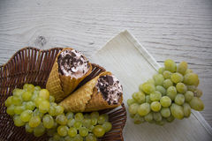 Green grapes and viennese waffers Royalty Free Stock Photography