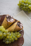 Green grapes and viennese waffers Royalty Free Stock Photo