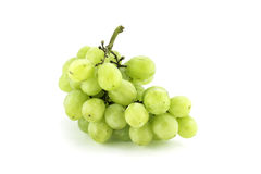 Green grapes on white background. Photo of a bunch of green grapes on white background Stock Image