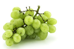 Green grapes on white background. Photo of a bunch of green grapes on white background Stock Images
