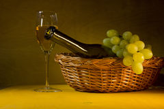 Green grapes and white wine stock image