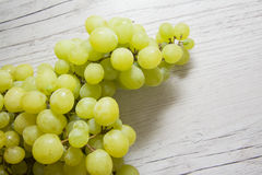 Green grapes on wood Stock Photo
