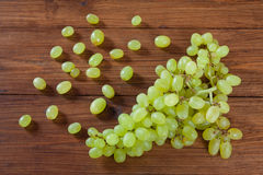 Green grapes on wood Royalty Free Stock Photos