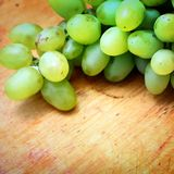 Green grapes. On wooden background Stock Photography
