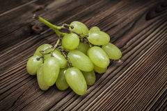 Green grapes on wooden background Stock Photo