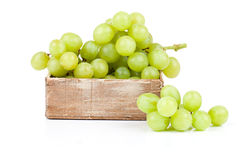 Green grapes in wooden box Royalty Free Stock Photos