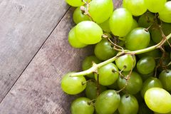 Green grapes on wooden table. Copyspace royalty free stock photography