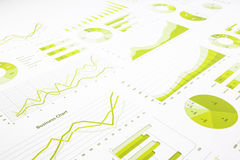 Green graphs, charts, marketing research and  business annual re. Port background, management project, and financial planning concepts Royalty Free Stock Image