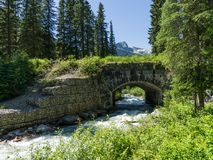 Nice river under the bridge at glacier national park in canada Stock Images