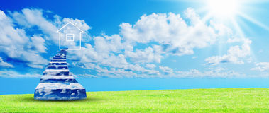 Green grass against a blue sunny sky Stock Image