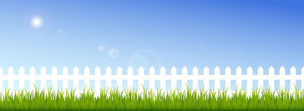 Green Grass And White Fence On A Clear Blue Sky Stock Images