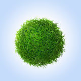 Green grass ball on blue background Royalty Free Stock Images