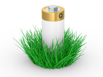 Green grass and battery, ecology concept Royalty Free Stock Photo
