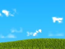 Green grass on blue sky background Stock Photo