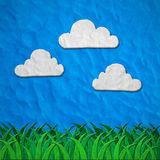 Green grass and blue sky with clouds made from toy clay Stock Photos