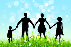 Green Grass and Blue Sky with Family Silhouettes Royalty Free Stock Images