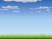 Green grass and blue sky. Fresh green grass and blue sky with clouds Royalty Free Stock Photography