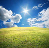 Green grass blue sky Royalty Free Stock Images