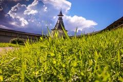 Green grass, blue sky, the old fortress. Pskov. Green grass on a background of the Pskov Kremlin and sky. Pskov. Old Kremlin Stock Images