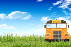Green grass, blue sky and the school bus Royalty Free Stock Image