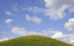 Green Grass, Blue sky, and White Clouds royalty free stock photography