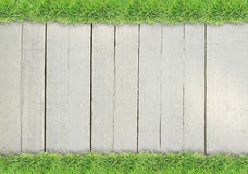 Green grass border on wood background Royalty Free Stock Photography