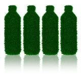 Green grass bottle's with shadows Stock Photography