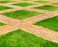 Green grass and brick paths Stock Images