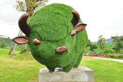 Green grass bull statue. Bull statue made of green grass royalty free stock image