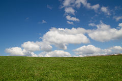 Green grass and cloudy sky. Beautiful mountain landscape. green grass and cloudy sky Royalty Free Stock Photo