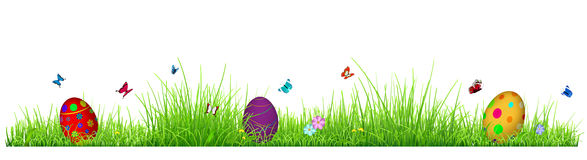 Green grass with Easter eggs. Flowers and butterflies isolated on white background Stock Photography