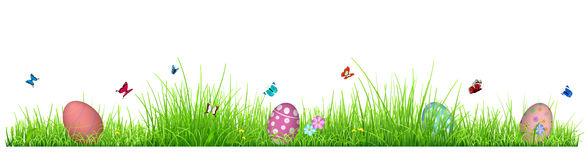 Green grass with Easter eggs. Flowers and butterflies isolated on white background Royalty Free Stock Images